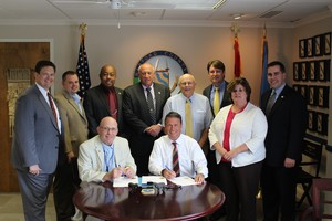 Signs Legislation Enacting Fiscal Year 2016 Budget